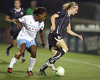 Becky Sauerbrunn #22 of the Washington Freedom shields the ball from Jessica McDonald #22 of the Chicago Red Stars during a WPS match at Maryland Soccerplex on August 19 2010, in Boyds, Maryland. Freedom won 2-0.
