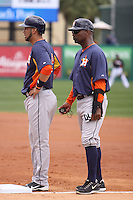 Houston Astros Marwin Gonzalez (9) and first base coach Dave Clark during the game against the Miami Marlins during a spring training game at the Roger Dean Complex in Jupiter, Florida on March 12, 2013. Houston defeated Miami 9-4. (Stacy Jo Grant/Four Seam Images)........