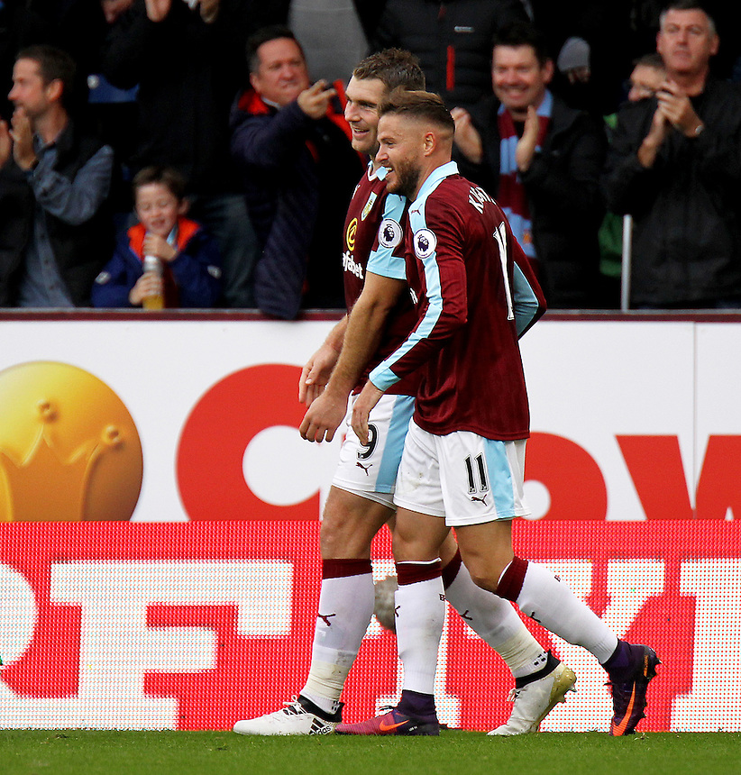 Burnley's Sam Vokes (left) is congratulated by team mate Michael Kightly as he celebrates scoring the opening goal <br /> <br /> Photographer Rich Linley/CameraSport<br /> <br /> The Premier League - Burnley v Everton - Saturday 22nd October 2016 - Turf Moor - Burnley <br /> <br /> World Copyright &copy; 2016 CameraSport. All rights reserved. 43 Linden Ave. Countesthorpe. Leicester. England. LE8 5PG - Tel: +44 (0) 116 277 4147 - admin@camerasport.com - www.camerasport.com