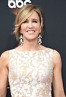 ***FILE PHOTO*** Felicity Huffman and Lori Loughlin Indicted in College Admission Bribery Case.<br /> LOS ANGELES, CA - SEPTEMBER 18: Felicity Huffman arrives at the 68th Emmy Awards at the Microsoft Theater on  September 18, 2016, in Los Angeles, California. Credit: mpi99/MediaPunch<br /> CAP/MPI99<br /> &copy;MPI99/Capital Pictures