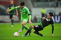 FUSSBALL   1. BUNDESLIGA    SAISON 2012/2013    13. Spieltag   VfL Wolfsburg - SV Werder Bremen                          24.11.2012 Zlatko Junuzovic (SV Werder Bremen) graetscht Diego (li, VfL Wolfsburg) ab