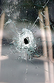 """Montgomery County, MD - October 3, 2002 -- Bullet hole in the window of the """"Crisp & Juicy"""" restaurant in the Leisure World Shopping Center where Sarah Ramos, a 34-year-old babysitter and housekeeper, was fatally shot on 3 October, 2002.  <br /> Credit: Ron Sachs / CNP <br /> <br /> (RESTRICTION: NO New York or New Jersey Newspapers or newspapers within a 75 mile radius of New York City)"""