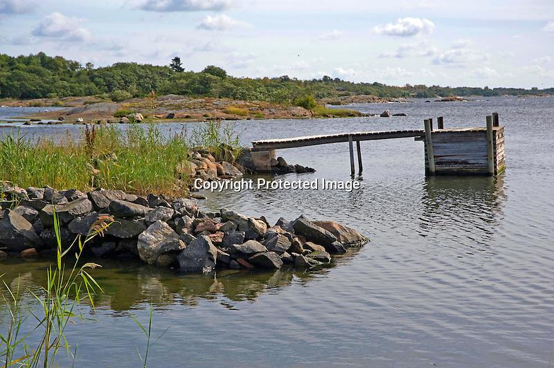 Old Wooden Boat Dock in Rocky Harbor on Baltic Island of Kökar