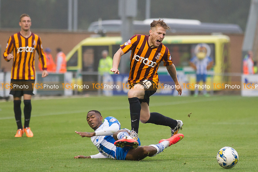 Sanchez Watt of Colchester United dispossesses Billy Clarke of Bradford City - Colchester United vs Bradford City - Sky Bet League One Football at the Weston Homes Community Stadium, Colchester, Essex - 20/09/14 - MANDATORY CREDIT: Ray Lawrence/TGSPHOTO - Self billing applies where appropriate - contact@tgsphoto.co.uk - NO UNPAID USE