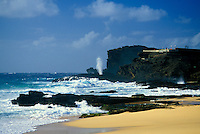 The Halona Blowhole spouts a plume of water from pounding surf, attracting visitors. Located near Sandy Beach on Oahu's southeastern coastline.