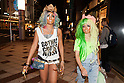 (L to R) Erimokkori of the Ganguro Cafe &amp; Bar walks with a female customer who has been transformed into a ganguro girl in the Shibuya shopping area on September 4, 2015. <br /> <br /> Ganguro is an alternative Japanese fashion trend which started in the mid-1990s where young women, rebelling against the traditional idea of Japanese beauty, wore colorful make-up and clothes and had dark-skin.<br /> <br /> 10 Ganguro fashion girls work in the new bar, which offers original Ganguro Balls (fried takoyaki style sausage balls in black squid ink batter) on its menu. Ganguro Caf&eacute; &amp; Bar also offers special services such as Ganguro make-up and the chance to take purikura (photo booth pictures) with staff and to look like a Ganguro girl walking around the Shibuya streets.<br /> <br /> The bar is popular with both Japanese and foreigners and has menus translated in English. (Photo by Rodrigo Reyes Marin/AFLO)