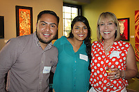 NWA Democrat-Gazette/CARIN SCHOPPMEYER Yamil Reyes (from left), Ana Aguayo and Elizabeth James visit at the Fayetteville Underground fundraiser June 23.