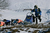 Sunday March 11, 2007   ----    Martin Buser runs up a hill on the tundra nearing Unalakleet on Sunday afternoon.
