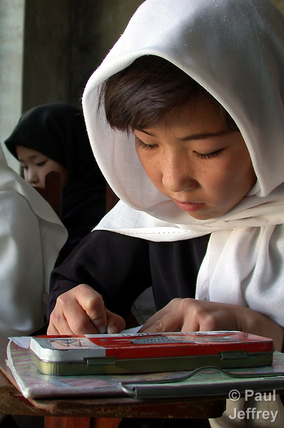 Afghan girls, denied an education under the Taliban, study in a school for refugee children in Quetta, Pakistan..