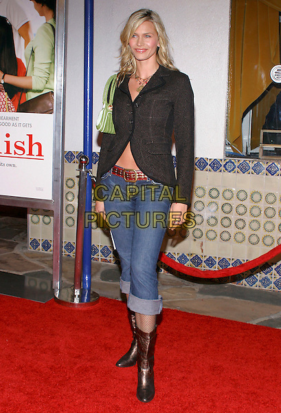 """NATASHA HENSTRIDGE.Attends the Los Angeles premiere of """"Spanglish"""" held at the Mann's Village Theatre, Westwood, California, USA, December 9th 2005..fuull length black jacket green bag.Ref: ADM.www.capitalpictures.com.sales@capitalpictures.com.©JWong/AdMedia/Capital Pictures ."""