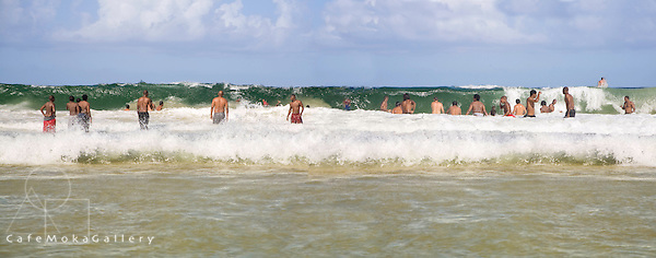 Panoramic multi-shot of big waves and bathers at Maracas beach