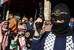 Palestinian Islamic Jihad militants take part in an anti-Israel rally in the town of Rafah in the southern Gaza Strip on December 18, 2015. A wave of violence has hit the Palestinian Territories, Jerusalem and Israel since October 1. The unrest has included unpredictable and seemingly unstoppable Palestinian knife and car-ramming attacks targeting Israelis. Photo by Abed Rahim Khatib