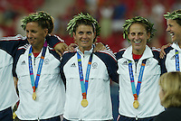 26 August 2004: Joy Fawcett, Mia Hamm and Kristine Lilly during the Gold Medal ceremony after defeating against Brazil, 2-1 in overtime at Karaiskakis Stadium in Athens, Greece.  Credit: Michael Pimentel / ISI.