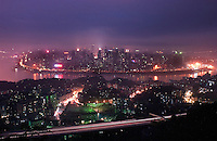 "Chongqing city overlooking the Yangtze river at night. Chongqing is China's largest city and is often termed a ""super-city"". It is at the far shore of the 600 km long Three Gorges Dam and is the ""gateway to western China"". Large sums of money are being pumped into the area and infrastructural projects and building development is ongoing.."