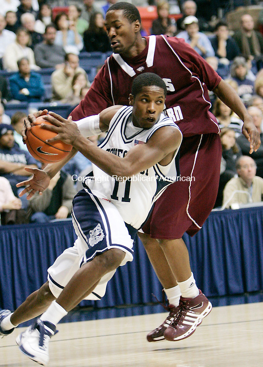 STORRS, CT. 03 December 2006--120306SV04--#11 Jerome Dyson of UConn drives tot he hoop as #23 Curtis Smith of Texas Southern defends during basketball action at Gampel Pavilion in Storrs Sunday. Steven Valenti Republican-American