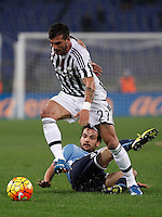 Calcio, Serie A: Lazio vs Juventus. Roma, stadio Olimpico, 4 dicembre 2015.<br /> Juventus&rsquo; Stefano Sturaro is challenged by Lazio&rsquo;s Marco Parolo, bottom, during the Italian Serie A football match between Lazio and Juventus at Rome's Olympic stadium, 4 December 2015.<br /> UPDATE IMAGES PRESS/Isabella Bonotto