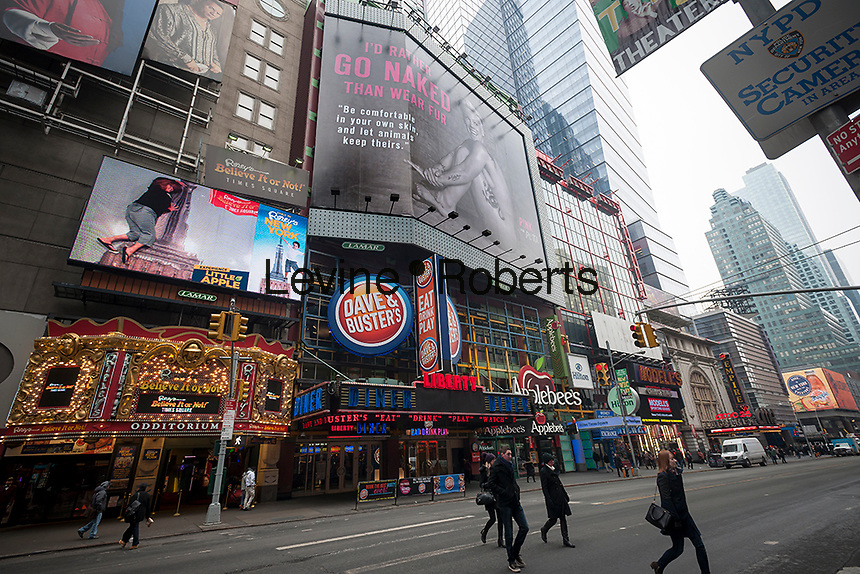 """A 90 foot billboard featuring a naked photo of performer Pink is unveiled in Times Square in New York on Thursday, February 12, 2015. Pink is participating in the animal rights group Peta's """"I'd Rather Go Naked Than Wear Fur"""" campaign. The photo is by noted photographer Ruven Afanador. Other celebrities that have participated include Olivia Munn, Pamela Anderson, and Wendy Williams among others. (© Richard B. Levine)"""