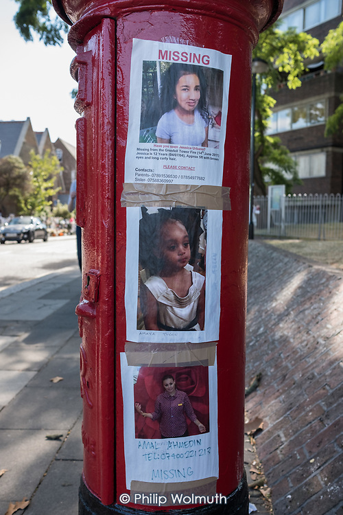 Missing posters of a post box  close to the site of the Grenfell Tower disaster, Kensington & Chelsea, London.