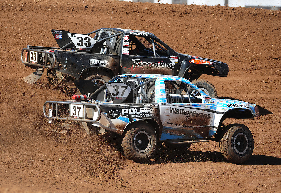 Apr 17, 2011; Surprise, AZ USA; LOORRS driver C.J. Greaves (33) races alongside R.J. Anderson (37) during round 4 at Speedworld Off Road Park. Mandatory Credit: Mark J. Rebilas-