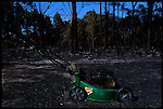 4-21-01.In North Port, Florida a lawn mower rests in peace after being ravaged by wildfires.