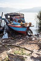 Old rusty fishing boat in a village at Lake Toba (Danau Toba), North Sumatra, Indonesia