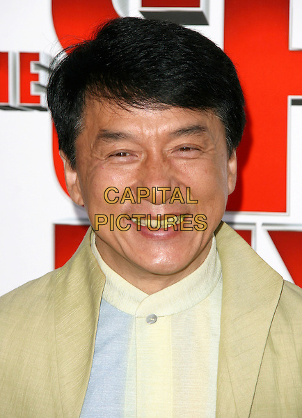 "JACKIE CHAN .at  the World Premiere of ""The Spy Next Door"" held The Grove in Los Angeles, California, USA, January 9th, 2010..portrait headshot  green smiling yellow.CAP/RKE/DVS.©DVS/RockinExposures/Capital Pictures"
