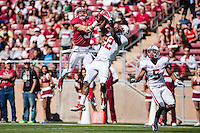 STANFORD, CA- April 13, 2013- The Stanford Cardinal and Whites Spring Game. Michael Rector makes a catch to score a touchdown against Kyle Olugbode during the Cardinal and White spring game. ..isiphotos.com..