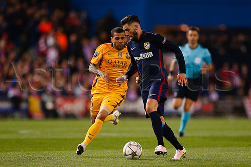 13.04.2016. Madrid, Spain.  Yannick Carrasco (21) Atletico de Madrid and Daniel Alver da Silva (6) FC Barcelona. UCL Champions League between Atletico de Madrid and FC Barcelona at the Vicente Calderon stadium in Madrid, Spain, April 13, 2016 .