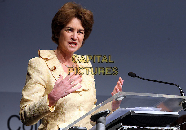 KATHLEEN KENNEDY TOWNSEND Speaks at the Economic Business Education Meeting for Women, Milan, Italy, 30th March 2009..half length yellow suit jacket hands speaking podium stand .CAP/ADM/LIV.©Francesco Bonfanti/Liverani/Admedia/Capital PIctures