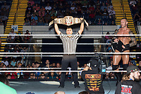 A referee holds up WWE Champion Jinder Mahal's belt before Mahal's match against Randy Orton at a WWE Live Summerslam Heatwave Tour event at the MassMutual Center in Springfield, Massachusetts, USA, on Mon., Aug. 14, 2017. Mahal lost the match.
