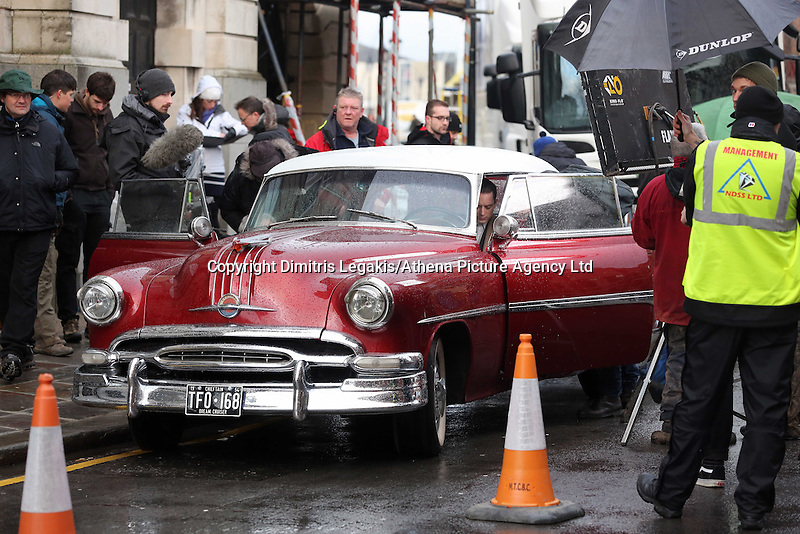 Pictured: Elijah Wood in a 1950s Pontiac Chieftain. Tuesday 11 February 2014<br /> Re: A Swansea street was transformed into 1950s New York for new Dylan Thomas biopic 'Set Fire to the Stars' starring Holywood actor Elijah Wood.<br /> Gloucester Place in Swansea Marina was used to film a snowy scene in New York.<br /> Half a dozen 50s American cars were used for the scene played by Elijah Wood and Celyn Jones.<br /> The new movie will explore the fractious relationship between Dylan Thomas played by Jones and John Malcolm Brinnin played by WOod, who brought the Welshman to the USA and acted as his tour agent.