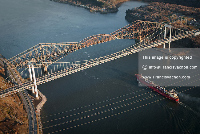 A ship passes under the Pont Pierre Laporte bridge and the Pont de Quebec bridge in Quebec city in this aerial photo November 11, 2009.