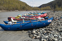 Catamarans and rafts participating in the annual Knik Canoers and Kayakers rafting class are pulled up at a lunch stop along the Matanuska River.