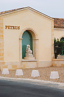 The newly renovated Chateau Petrus with a sign with the name in gold and a stone statue of Peter the Apostle in a boat with fishing net in a niche Pomerol Bordeaux Gironde Aquitaine France