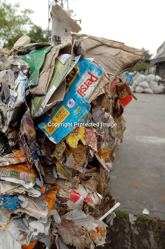Bales of waste paper and plastic that has been imported from Europe are piled up outside a factory in Shunde district of Guangdong, China.  Italian, Dutch and British waste was found in the area.<br /> Photo by Richard Jones / Sinopix
