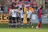 Luke Young of Wrexham scores the first goal for his team and celebrates during Dagenham & Redbridge vs Wrexham, Vanarama National League Football at the Chigwell Construction Stadium on 13th October 2018