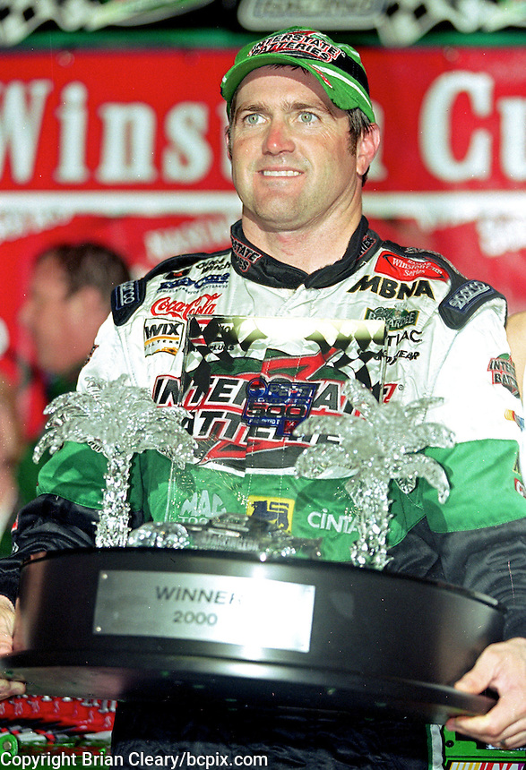 NASCAR driver Bobby Labonte holds his trophy in Victory Lane after winning the rain-shortened Pepsi Southern 500 at Darlington, SC on Sunday, 9/3/00. (Photo by Brian Cleary)  (Photo by Brian Cleary/www.bcpix.com)