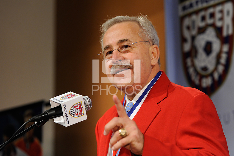 Hall of Fame member Hank Steinbrecher presents inductee Thomas Dooley (not pictured) during the induction ceremony for the National Soccer Hall of Fame at the New Meadowlands Stadium in East Rutherford, NJ, on August 10, 2010.