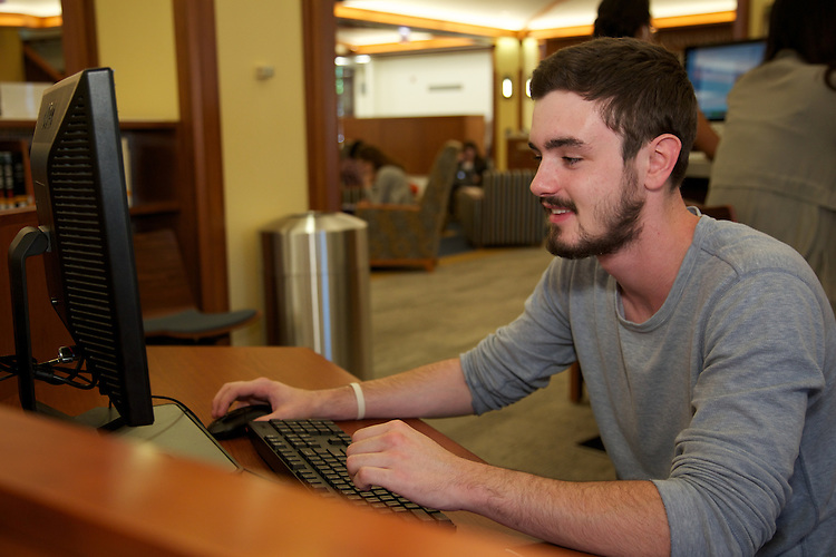 Jacob Furst utilizes a PC workstation in the DePaul University John T. Richardson Library Information Commons. (Photo by Jeff Carrion)
