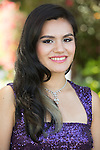 Outdoor portrait of a Greek-Lao young woman in a purple sequinned evening gown