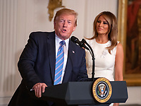 United States President Donald J. Trump and First lady Melania Trump participate in the Celebration of Military Mothers in the East Room of the White House in Washington, DC on May 10, 2019. Photo Credit: Ron Sachs/CNP/AdMedia