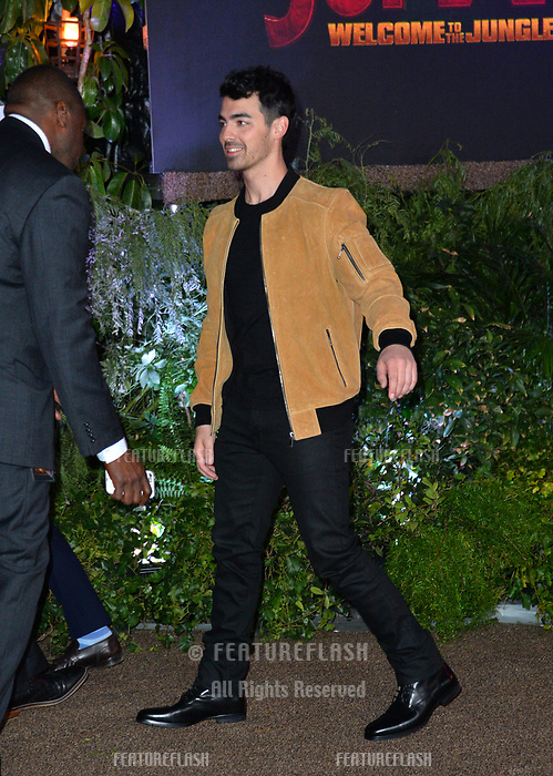 Joe Jonas at the Los Angeles premiere of &quot;Jumanji: Welcome To the Jungle&quot; at the TCL Chinese Theatre, Hollywood, USA 11 Dec. 2017<br /> Picture: Paul Smith/Featureflash/SilverHub 0208 004 5359 sales@silverhubmedia.com