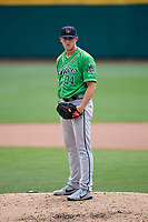 Gwinnett Stripers relief pitcher Evan Phillips (34) looks in for the sign during a game against the Columbus Clippers on May 17, 2018 at Huntington Park in Columbus, Ohio.  Gwinnett defeated Columbus 6-0.  (Mike Janes/Four Seam Images)