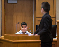NWA Democrat-Gazette/BEN GOFF @NWABENGOFF<br /> Cash Arnhart (right), acting as the prosecuting attorney, questions Franky Rosales, portraying a witness, Wednesday, March 7, 2018, as 5th grade students from Frank Tillery Elementary in Rogers hold a mock trial at Rogers District Court. The students put on costumes and portrayed historical figures from the American Revolution, putting Benedict Arnold on trial for treason and Capt. Thomas Preston on trial for murder in the Boston Massacre.