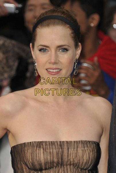 Amy Adams<br /> 'Man Of Steel' UK film premiere, Empire cinema, Leicester Square, London, England.<br /> 12th June 2013<br /> headshot portrait beige black strapless pattern alice band dangling earrings brown<br /> CAP/DS<br /> &copy;Dudley Smith/Capital Pictures