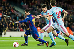 Lionel Andres Messi (L) of FC Barcelona is tackled by Jozabed Sanchez Ruiz (C) of RC Celta de Vigo during the Copa Del Rey 2017-18 Round of 16 (2nd leg) match between FC Barcelona and RC Celta de Vigo at Camp Nou on 11 January 2018 in Barcelona, Spain. Photo by Vicens Gimenez / Power Sport Images