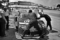 Wearing the distinctive colors of long-time sponsor Coca-Cola, the Bob Akin Motor Racing Porsche 935 is refueled in the pit lane during practice for the 1982 12 Hours of Sebring. Akin, Derek Bell and Craig Siebert drove the car to a 12th place finish.