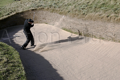 2 October 2005: Danish amateur Gerry Tvedt (DEN) playing out of a greenside bunker on the 7th during the final round of the Dunhill Links Championship on the Old Course at St Andrews, Scotland. Photo: Glyn Kirk/Actionplus...051002 man men golf player sand trap.