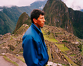 PERU, Machu Picchu, South America, Latin America, side view of a man with Machu Picchu in the background.