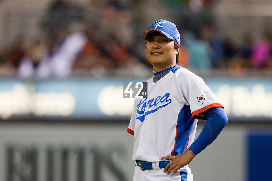 17 March 2009: #35 Jin Young Lee of Korea warms up prior to the 2009 World Baseball Classic Pool 1 game 4 at Petco Park in San Diego, California, USA. Korea wins 4-1 over Japan.